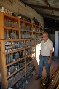 Jeff with a small section of his Thousands of Old Australian Bottles in his collection