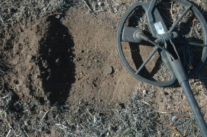 E-Trac Metal Detector and a found coin - Australian Penny